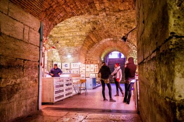 Tourists take a tour of the historic cellars of the Roman Emperor Diocletian in Split, Croatia
