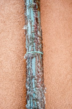 Frozen copper pipe. Water drain from house roof.