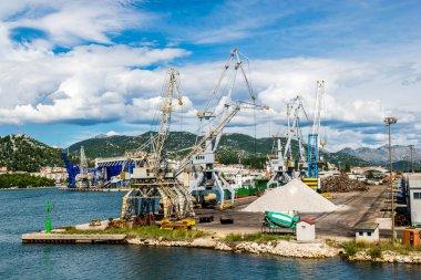 PLOCE, CROATIA - AUGUST 6, 2014: Bulk cargo with port infrastructure in Port Ploce, largest sea port in southern Croatia.