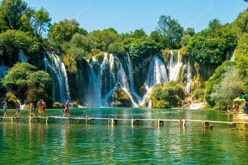 LJUBUSKI, BOSNIA AND HERZEGOVINA - AUGUST 10, 2014: Many tourists visit Kravice waterfalls on Trebizat River near Ljubuski in Bosnia and Herzegovina.