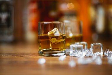 Whiskey drinks on wood