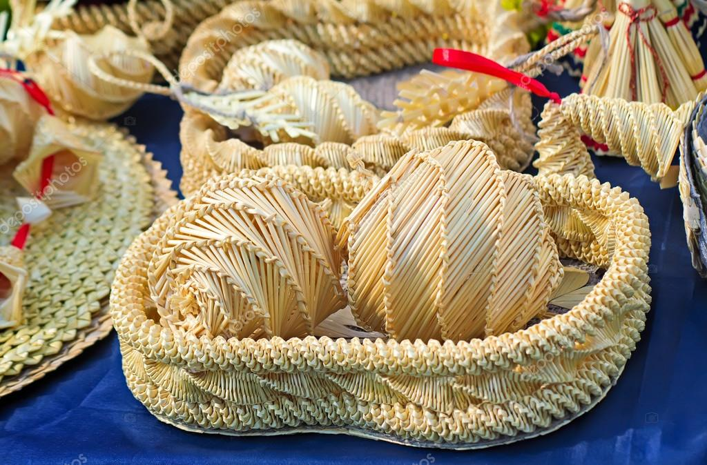 Original Souvenirs of woven straw are sold at the fair.