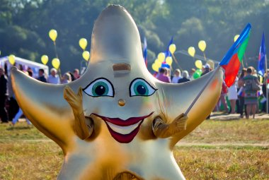Funny carnival costume in the form of stars at the festival