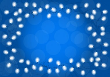 christmas lights on blue background with space for text