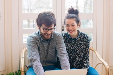 Cute young couple with laptop