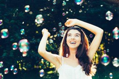 Girl having fun with bubbles