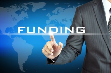 Businessman's hand touching FUNDING word