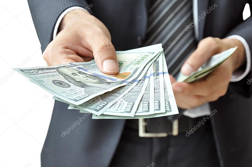 Hand giving money Dollars