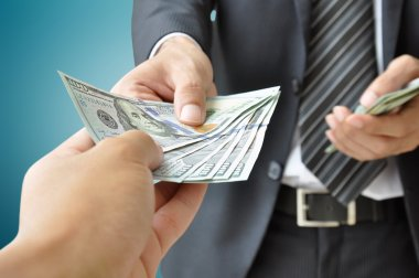 Hand receiving money from businessman