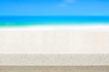 White stone countertop on blurred beach background