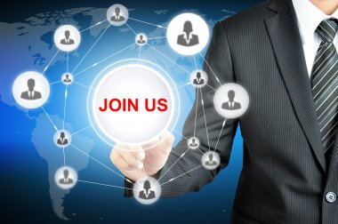 Businessman hand pointing on JOIN US sign on virtual screen