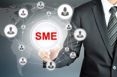 Businessman pointing on SME (Small & Medium Enterprise) sign on virtual screen