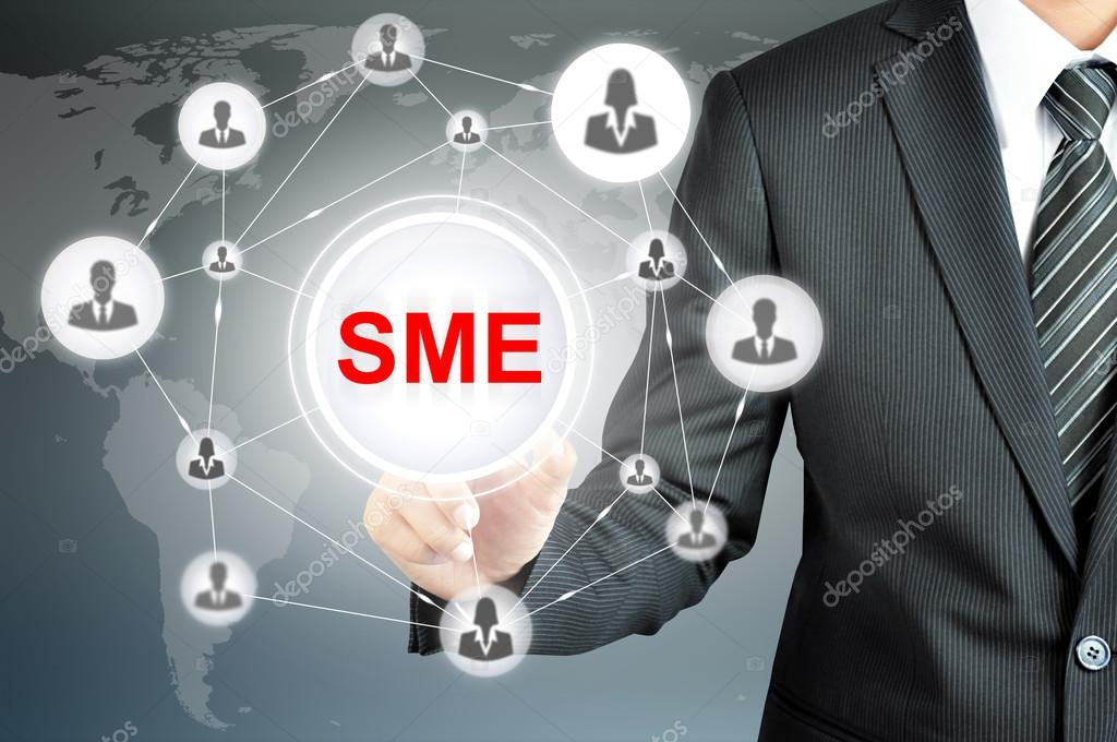 Businessman pointing on SME (Small & Medium Enterprise) sign on virtual screen