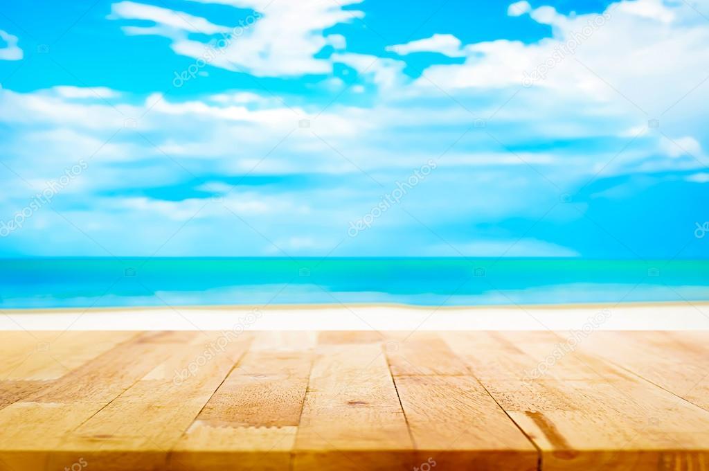 Madera mesa de playa de arena blanca de desenfoque y fondo ...