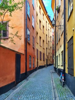 Narrow street with colorful buildings in Stockholm