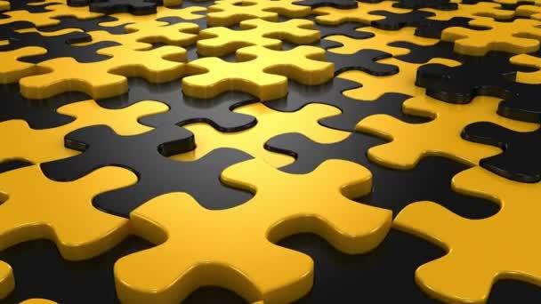 Pozadí tvoří z pohybující se puzzle