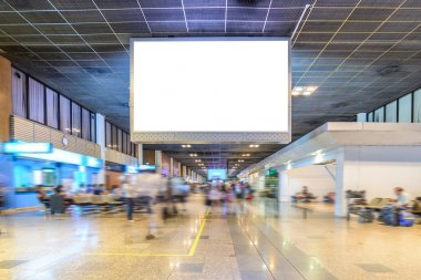 TV screen advertising at airport terminal.