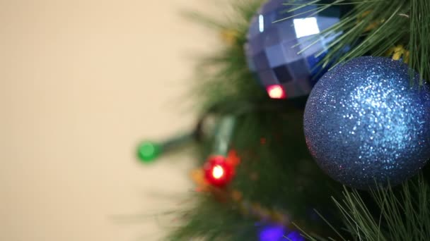 A bunch of blue balls on the Christmas tree. Christmas background