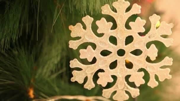 Christmas ornaments snowflake hanging on a branch. Background