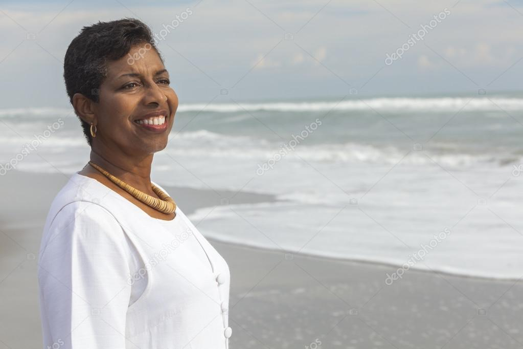 Happy Proud Senior African American Woman on Beach