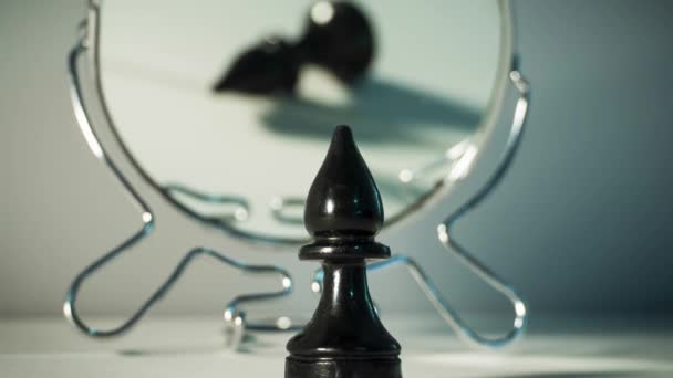 A chess piece is reflected in the mirror. Things and people are not what they seem. Reassessment of their abilities. Psychology, motivation. Power of thought. Never give up, always go for your goal.