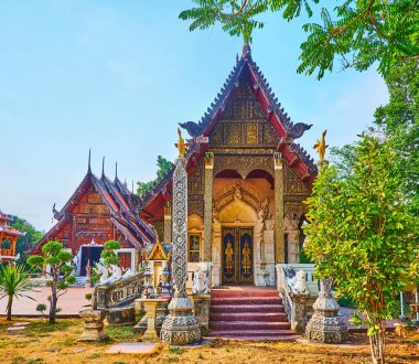 The Viharn of Wat Pratu Pong, richly decorated with carved patterns, gilt, stucco and sculptures of Thai mythical creatures, Lampang, Thailand