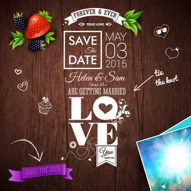 Wedding invitation on wooden background.