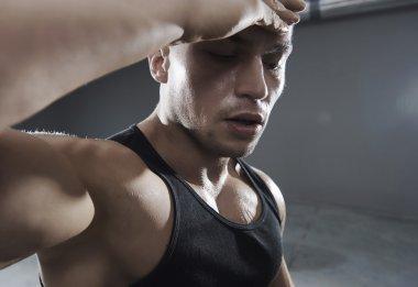 Tired man during workout
