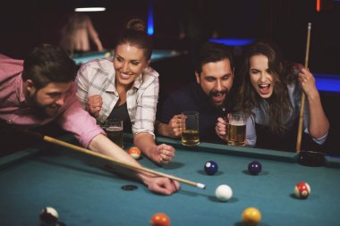Friends playing pool game