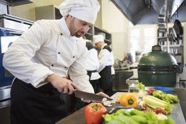 Chef chopping fresh vegetables