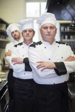 Chefs posing in the commercial kitchen