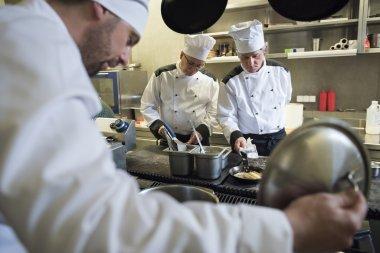 Hardworking chefs working at dinner