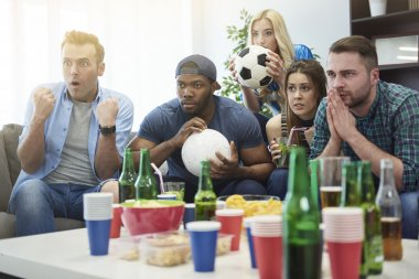 Friends watching football match