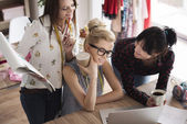 Fashion designers during work