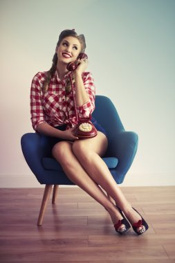 Pin up girl talking on the phone