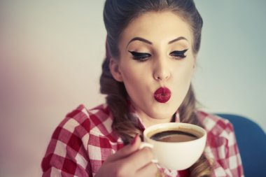 Pin up girl drinking coffee