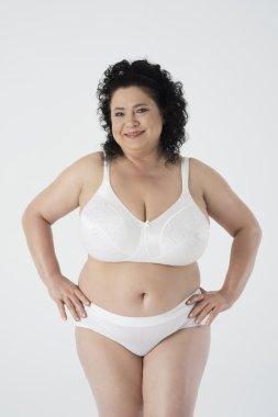 Happy mature woman in underwear