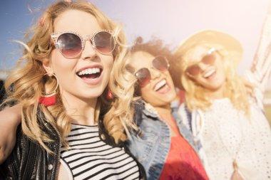 Fashionable happy women in sunglasses.