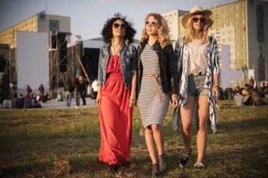 Fashionable girls enjoying at the music festival