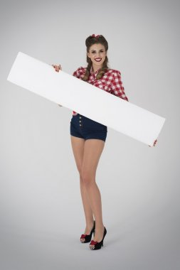 Pin up girl holding white placard