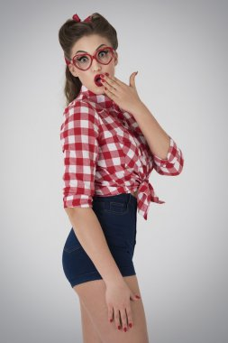 Pin up girl wearing heart shaped eyeglasses.