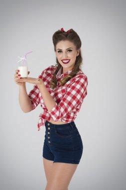 Pin up girl presenting milk