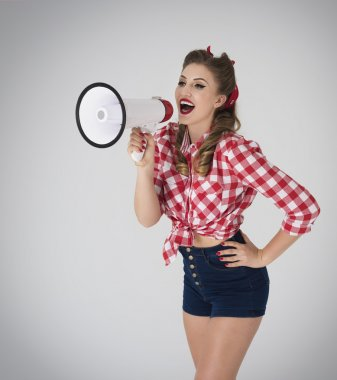 Pin up girl shouting through megaphone