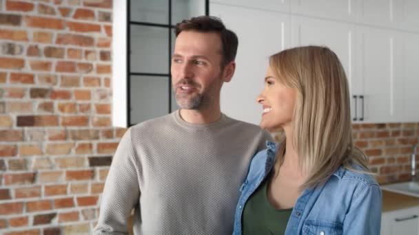 Close up video of couple receives the keys to a new apartment. Shot with RED helium camera in 8K.