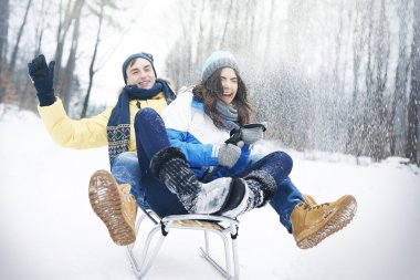Young couple have fun outdoors in winter stock vector