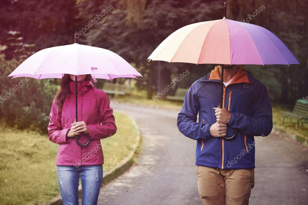 Loving couple with umbrella