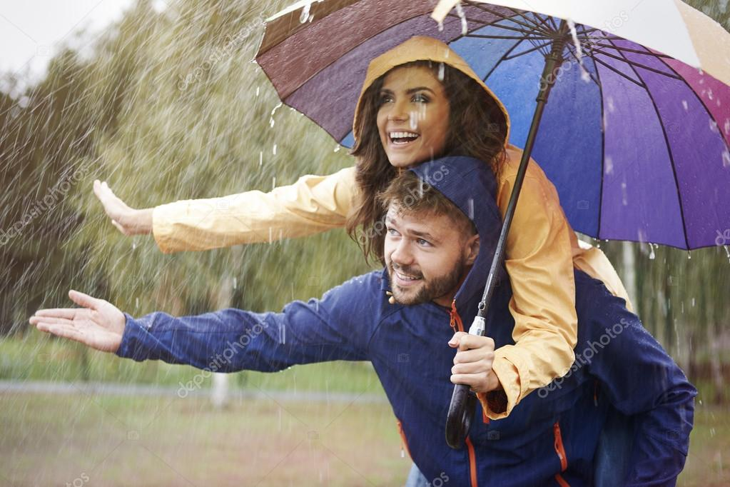 Loving couple in rain