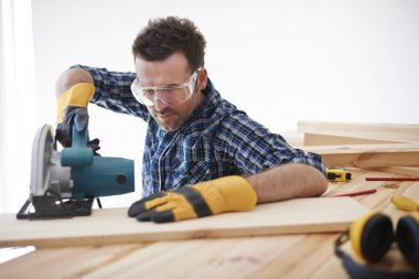 Young handsome carpenter man planning to work stock vector