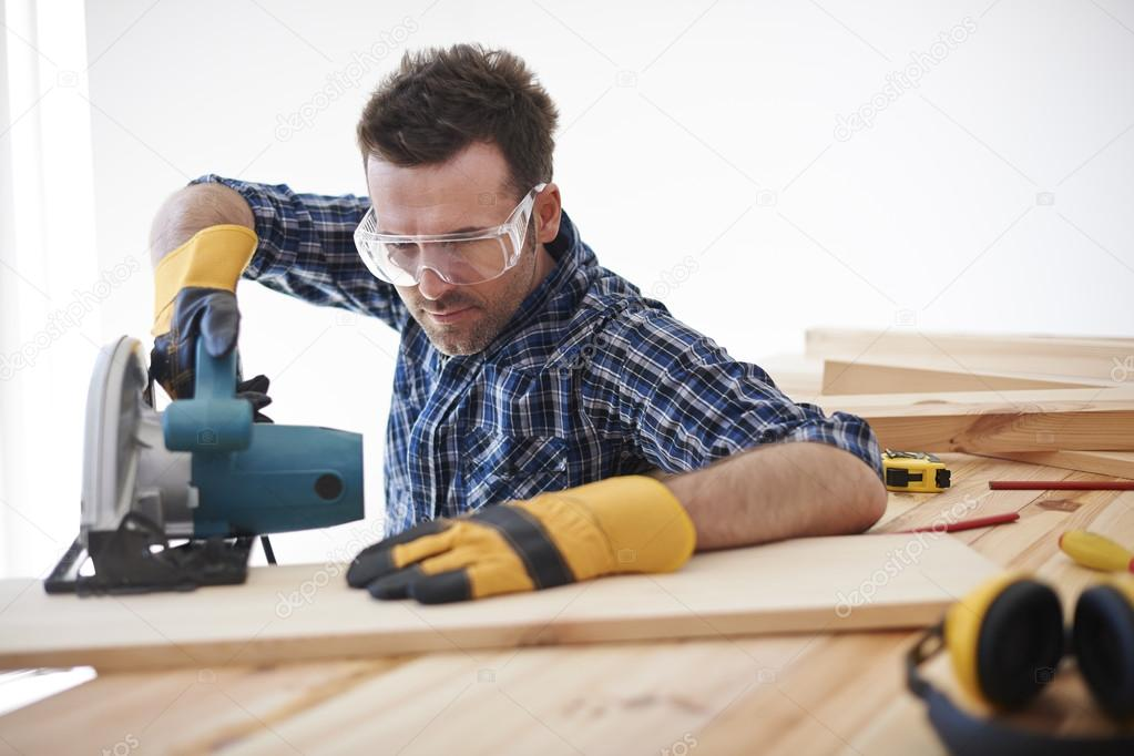 Young handsome carpenter
