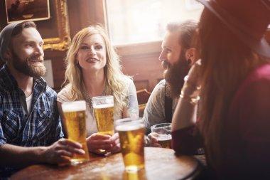 Friends meeting in bar